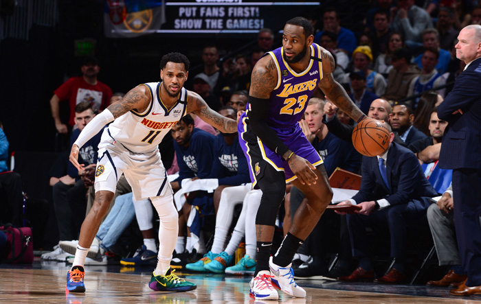 Lakers edge Nuggets in overtime
