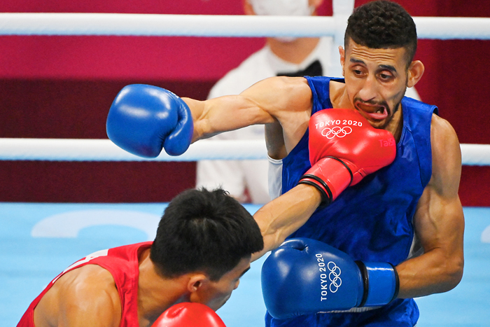The Philippines' Carlo Paalam sneaks in a left straight to the face of Algeria's Mohamed Flissi fight during their men's fly (48-52kg) preliminaries round of 16 boxing of the Tokyo 2020 Olympic Games at the Kokugikan Arena in Tokyo. AFP