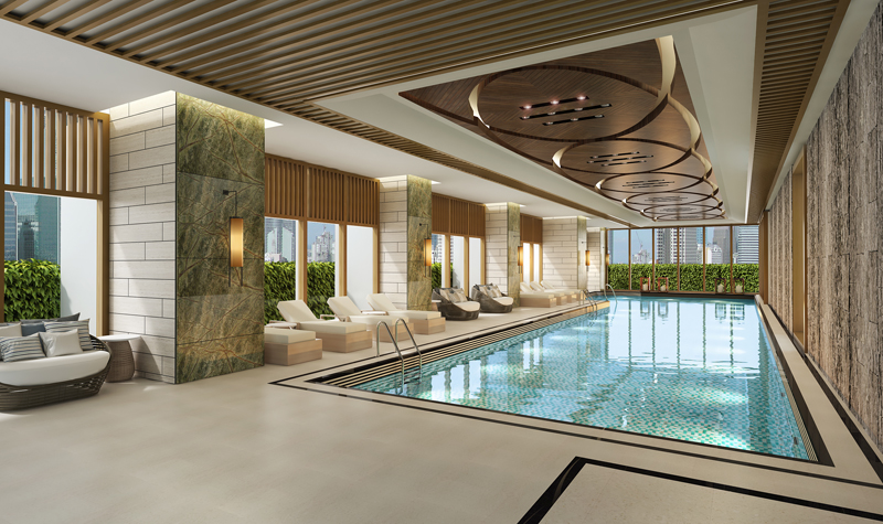 The upscale condominium takes pride in its indoor lap pool (top), one of the amenities at The Haven, and its hotel-like grand lobby (below) that welcomes residents and their guests.