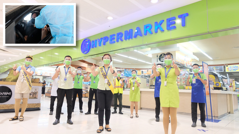 Fully vaccinated employees of SM Hypermarket at SM City North Edsa. (Inset) The drive-thru vaccination site at the mall caters to Quezon City citizens under the A1, A2, A3, and A4 priority list.