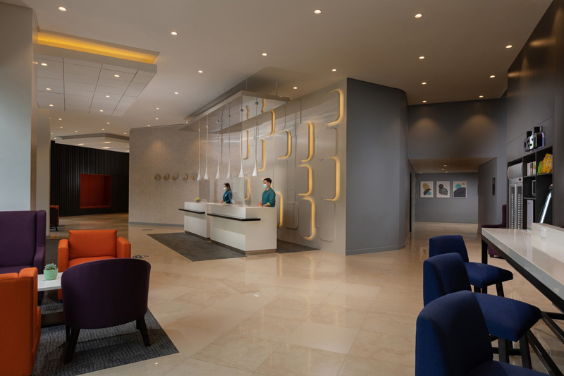 The uncluttered and modern lobby of the hotel.