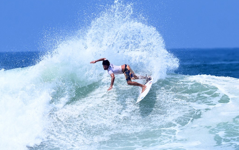 French surfer Jeremy Flores rides a wave in the men's main round during the 2021 Isa World Surfing Games at the El Tunco beach in El Salvador. AFP