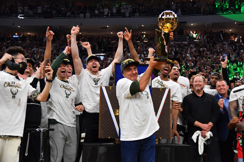 Milwaukee Bucks Owner, Marc Lasry holds up the Larry O'Brien trophy after winning Game Six of the 2021 NBA Finals against the Phoenix Suns at Fiserv Forum in Milwaukee, Wisconsin. AFP