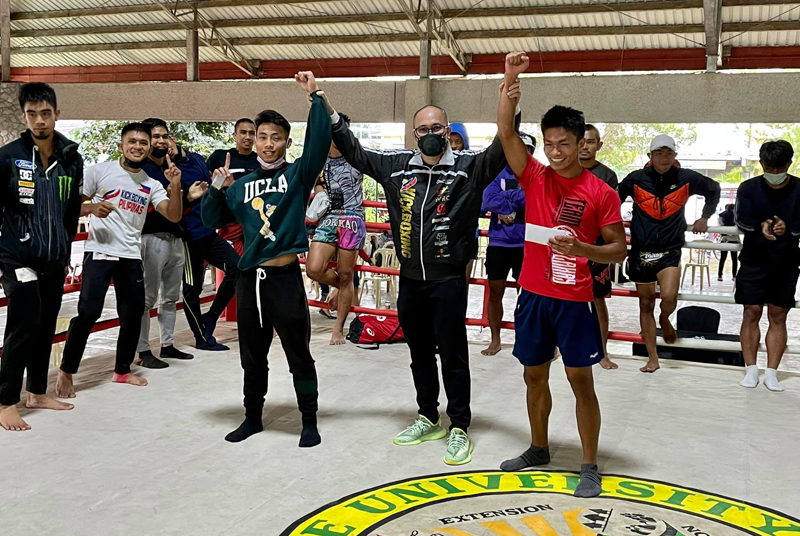 Samahang Kickboxing ng Pilipinas (SKP) Bing Domingo hands cash prizes to Darryl Chulipas and Estrada Dong-as after their final bout in the men's 51KG emerged as the Best Fight of the tournament.