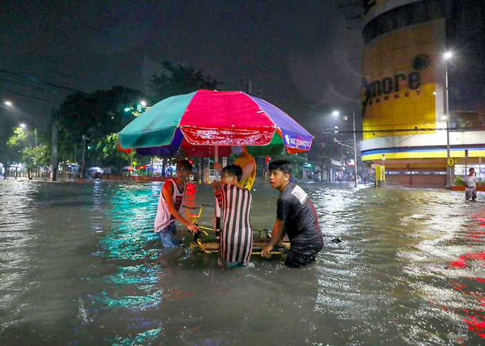 Widespread flooding displaces over 15,000 people