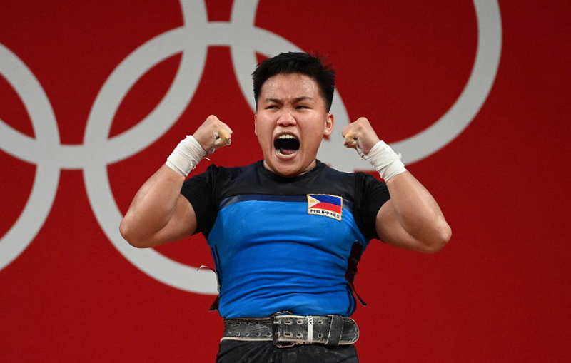 The Philippines' Elreen Ann Ando reacts during the women's 64kg weightlifting competition during the Tokyo 2020 Olympic Games at the Tokyo International Forum in Tokyo. AFP