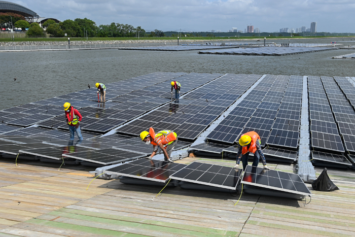 Space-starved Singapore builds floating solar farms