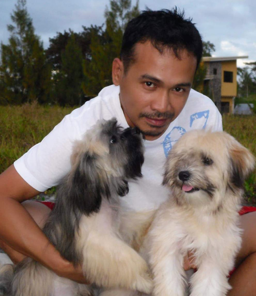 Ali Naim and his two dogs, Ava and Tsoko.
