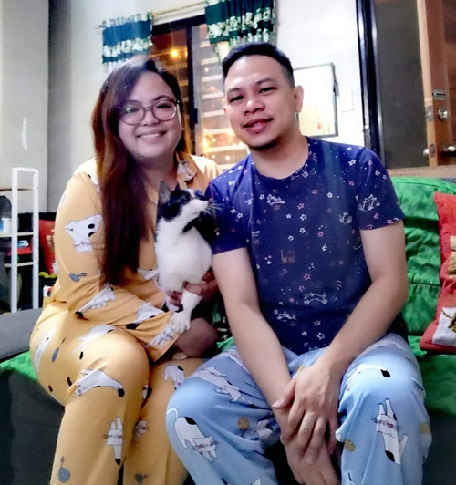 Charlene and Lance Arevalo and their cat Tech