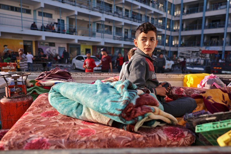 UNSETTLED. A Palestinian boy who fled his home due to Israeli air and artillery strikes sits on a mattress outside at a school hosting refugees in Gaza city on May 14, as cross-border violence between the Israeli military and Palestinian militants continues in the Gaza Strip. AFP