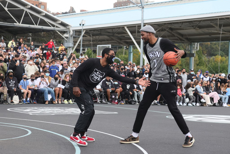 Kyrie Irving of the Brooklyn Nets plays defense on teammate Kevin Durant during the Practice in the Park at Brooklyn Bridge Park in Brooklyn, New York. AFP