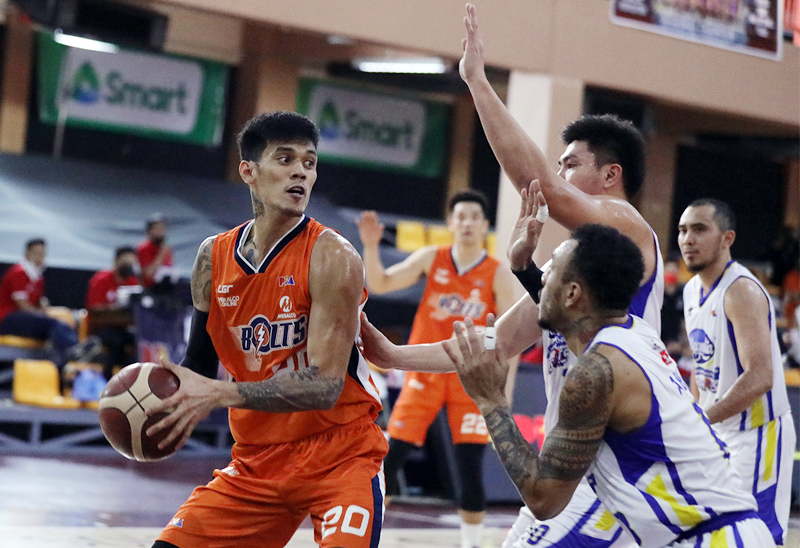 Meralco's Raymund Almazan is challenged by Ian Sangalang and Calvin Abuevain a PBA Philippine Cup semifinal game won by the Bolts, 102-98.