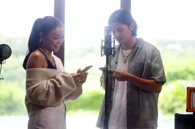 """Former reel and real-life couple James Reid and Nadine Lustre team up to film the digital video of their duet, """"Complicated Love."""""""