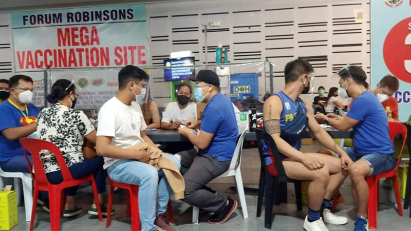 First batch of Axis Residences homeowners inoculated at Robinson's Mall Forum on Aug. 20.