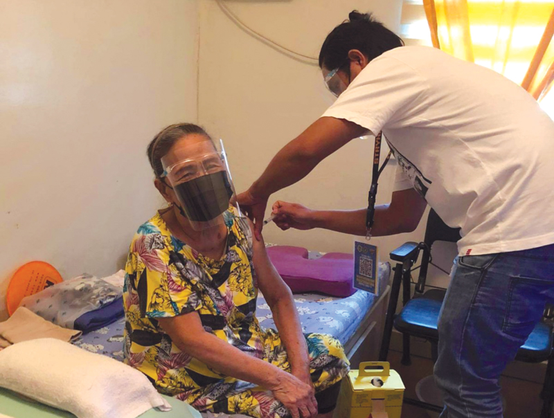 Senior homeowners receive their first dose inside their homes.
