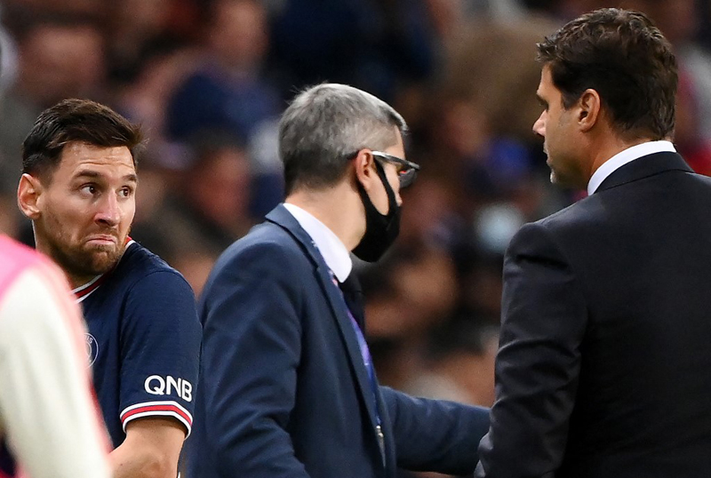 Paris Saint-Germain's Argentinian forward Lionel Messi (left) leaves the pitch after chatting with Paris Saint-Germain's Argentinian head coach Mauricio Pochettino during the French L1 football match between Paris-Saint Germain and Olympique Lyonnais at The Parc des Princes Stadium in Paris. AFP