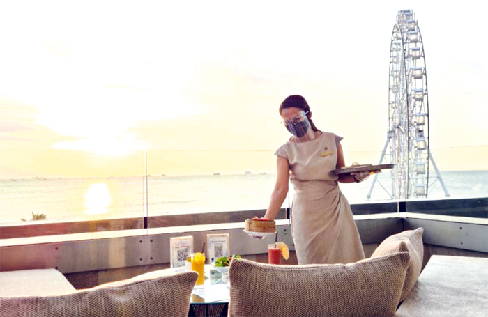 Have a front-row seat to Manila Bay's breathtaking sunset at C Lounge in Conrad Manila.