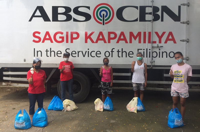 ABS-CBN Foundation delivers food packs and hot meals to Filipinos hit by typhoon and pandemic.