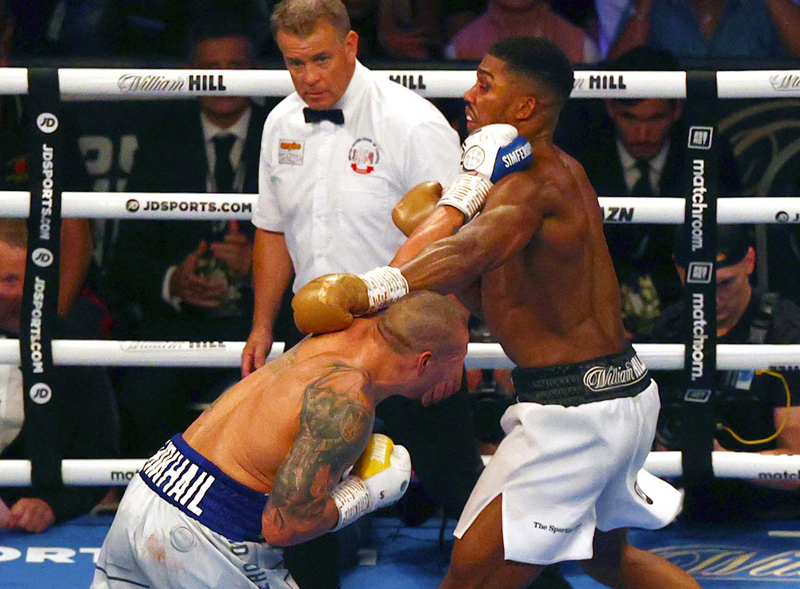 Ukrainian boxer Oleksandr Usyk (left) fights British heavyweight champion boxer Anthony Joshua at the end of their heavyweight boxing match at Tottenham Hotspur Stadium in north London. Usyk defeated Joshua on points. AFP